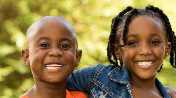 African American kids smiling.